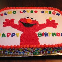 Jason's 2Nd Birthday Cake This was my son's 2nd birthday cake. The letters are fondant, the rest is BC. Those are M&M Minis on the sides.