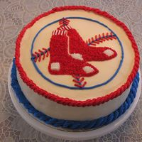 Red Sox Baseball Logo Cake  I made this for my husband's birthday. He's a huge BoSox fan. It is a super-moist carrot cake with cream cheese frosting. I used...
