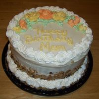 Moms Birthday Cake This is a carrot cake frosted with cream cheese frosting, roses are buttercream.