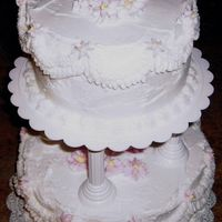 2-Tier Cake For Course 3 2-tier bridal shower cake - white BC frosting with light pink flowers and yellow centers.