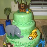 Zoo Wild Animal Cake  This cake was made for a birthday at a wild animal park and is two layers of vanilla cake with strawberries 'n cream filling, and one...