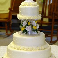 Cakes8_021.jpg 50th anniversary cake. All buttercream with roses for bottom borders and fresh flowers in the middle.