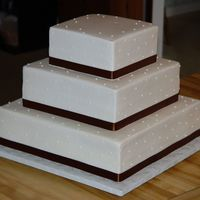 Cakes8_277.jpg 16, 12, and 8 in. Buttercream with fabric ribbon.