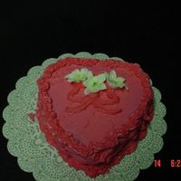 Valentine Cake My heart cake, with buttercream icing.....Lilies is made out of Royal icing..