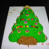 My Christmas Tree Cake Here is my christmas tree cake, I was practicing on....I am making one for my neighbor, so I decided to practice....I used m&m's...