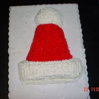 Santa Hat I made this cake for my Boyfriends, Mother Christmas Eve Party.....I used party hat pan and star the icing......I know I got the Stars down...