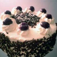 Black Forest Cake Your typical black forest cake. Chocolate cake layers with chocolate whipped cream filling and kirsch-soaked cherries. Frosted in regular...