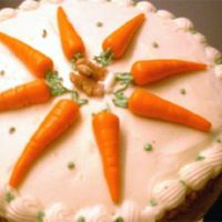 First Cake- Carrot Cake First cake made at home, by myself. Scratch carrot cake with cream cheese frosting. Made carrots out of homemade marzipan (dyed orange),...