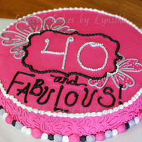 40 And Fabulous Freehand buttercream decorations with white & silver nonpareils, and silver edible color.