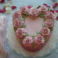Valentines Heart Cake Strawberry cake w/ BC icing. Mauve roses made from royal icing.