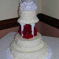 My First Wedding Cake My partner and I used French Vanilla with buttercream icing. The bride wanted swiss dots. The roses are real. We were so nervous, this...