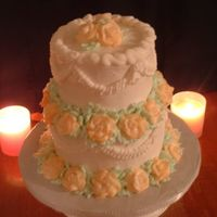 031.jpg Lemon cake covered in butter cream.All butter cream decorations.Roses done with white butter cream,& highlighted in orange with...