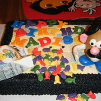 Madisons_Birthday_3_002.jpg fruit punch cake with raspberry flavored butter cream.The letters & goldfish are made of fondant.The Mr.Potato Head &the carton are...