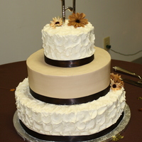 Red Velvet Fall Wedding Cake 14'', 10'', and 6'' tiered wedding cake. The top and bottom tiers are red velvet cake with red velvet icing....