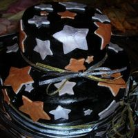 2 Layer Rounds With Stars This cake is chocolate/vanilla swirl with buttercream filling. Covered in fondant and with fondant star accents. On the picture it looks as...