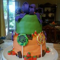 Halloween Themed Cake Based on a cake I saw online. Sorry I can't remember who the original artist is. My first stacked fondant cake. I've only...