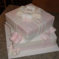 Baby Shower Cake For Twin Girls!   Bow's, booties, and box sides all fondant, rest is buttercream.