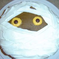 Mummy Easy mummy cake for work Halloween party. Think crumb coat and covered the rest with ribbon tip.