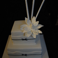 2 Tier Square Black And White Wedding Cake With Magnolia And Bamboo This was a cake I made in the fantastic Planetcake course I did last week. It is a 2 tier choclate mudcake with ganache and fondant. It has...