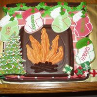 Holiday Around The Hearth  Bottom layer is a sheet cake decorated as a fireplace. The back drop of the fire is a large chocolate square. Stockings were made of...