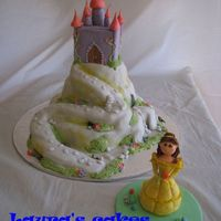 Enchanted Castle This is inspired on one of Debbie Brown's cake. I was pleased with the result.The Belle figurine is all fondant and took a while but...