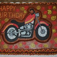 Motorcycle Birthday Cake I made this cake for my neighbor's 4-yr-old son and he loved it, I'm not much of an artist but the motorcycle was still a hit.