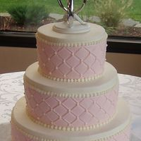 Pink & White Diamon Impression This was such a simple cake to do but I just love the way it looks. 3 Tiered Red Velvet w/ Bavarian Creme filling and Iced in Buttercream....