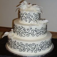 "Black Scrollwork & White Calla Lilies This is 6"", 9"" & 12"" - all iced in Buttercream. The black scrollwork is also done in Buttercream. The bride specifically..."