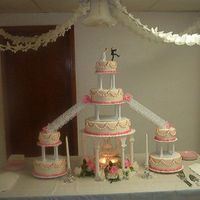 Pink Wedding Cake This is a huge cake, it is as big as it looks. It's a 6 10 and 14 center cakes with 6 and 10 inch satellite cakes on either side. This...