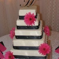 Black/fusia Daisy Wedding Cake This is my favorite wedding cake that I've done so far. It's all buttercream icing, the ribbon is satin and is held on with...