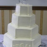 Hexagon Cake  This cake is all white, with white monogrammed inititials on it, that's what the bride wanted. She brought me a pic, and that's...