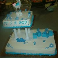Baby Shower Cake  This is a cake that I did with a friend of mine, I was teaching her the basic ropes of cake decorating, and I was doing the other pictured...