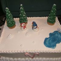 Frosty The Snowmen :)   Made this winter themed cake for a Daycare Christmas Party.Fondant snowmen, royal icing trees.