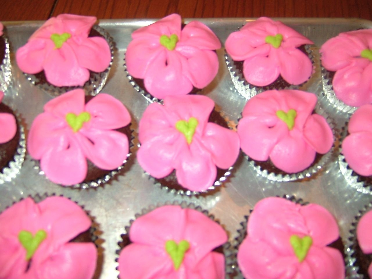 Flower Cupcake   Made these cup cakes to go with a Tinkerbell Cake I made.Added heart center for a cute added touch