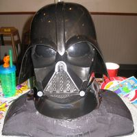 Darth Vader  I made this for my son's 5th bdaythe pic does not show that the cake is as black as it really is.And i don't have a clue where...