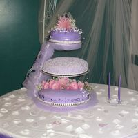 Purple Fondant Wedding Cake 3 tiers - Chocolate with Raspberry Buttercream filling. Made for my friends wedding. She loves purple and went with a purple theme.