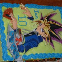 My Son Ian's 10Th Birthday Cake 2006 He is a Yugioh fan. This one is done with a plastic cover that you apply to the cake. Made it really easy.