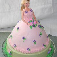 "Cori's Doll Cake  Hannah Montana doll cake. Dress is wasc, 10"" is chocolate. Frosted in buttercream with RI flowers. This is my first paid cake, and..."