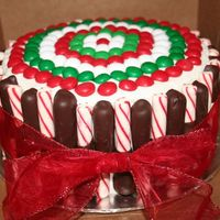 "Mc Christmas Cake  8"" Dark Chocolate cake with peppermint buttercream. Soft peppermint sticks dipped in chocolate. Peppermint M&M's. Thank you..."