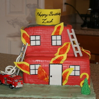 Firetruck And Burning Building. This was for a friend's son who had a fire engine themed birthday. The truck is his toy and not edible.