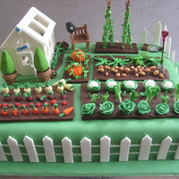 Vegetable Garden Cake 50th birthday cake for a keen gardener. He's also a policeman, hence the helmet on the bench