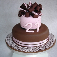21St Birthday Cake For my daughter's 21st. Chocolate flavoured fondant on the bottom layer.