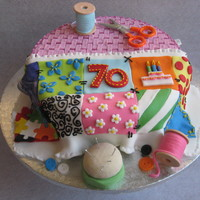 70Th Birthday Cake - Sewing Basket With Patchwork Quilt This cake was for a 70th birthday. The lady is very keen on patchwork quilting.All the bits and pieces are made of gum paste or fondant and...