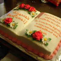 Baptismal Bible Cake Marble cake with buttercream frosting. Decorated with royal icing roses and daisies.