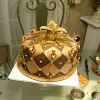 Fleur De Lis This cake was made for a friend's, brother's 21st b-day. It's Gold on milk chocolate on dark chocolate on chocolate...