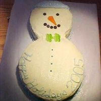 Snowman  A christmas/wedding gift for my landlords. White chocolate cake with white chocolate buttercream. My husband was very insistant that I wite...
