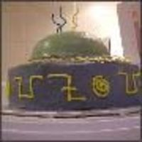 "Ufoside   My son's 3rd birthday cake. Chocolate fudge cake with IMBC. It says UFO UFO UFO in ""alien writing all around the side"