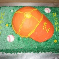 Baseball Cap  Birthday cake for a friend's child. Chocolate sheet cake and half sportball cake. The bill of the cap is orange candy melts. Iced in...