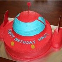 Disney's Little Einsteins Rocket Cake I MADE THIS FOR A FRIEND'S SON. I USED A 9 INCH ROUND FOR THE BOTTOM, HALF OF THE 3D SPORTS BALL FOR THE DOME, AND THEN TWO TWINKIES...