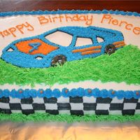 Race Car Cake I TRACED THE OUTSIDE IMAGE OF THE CAR ONTO THE CAKE THEN FREE HANDED THE DETAILS. I LOVE USING THE 'GRASS' TIP SO I HAD FUN WITH...
